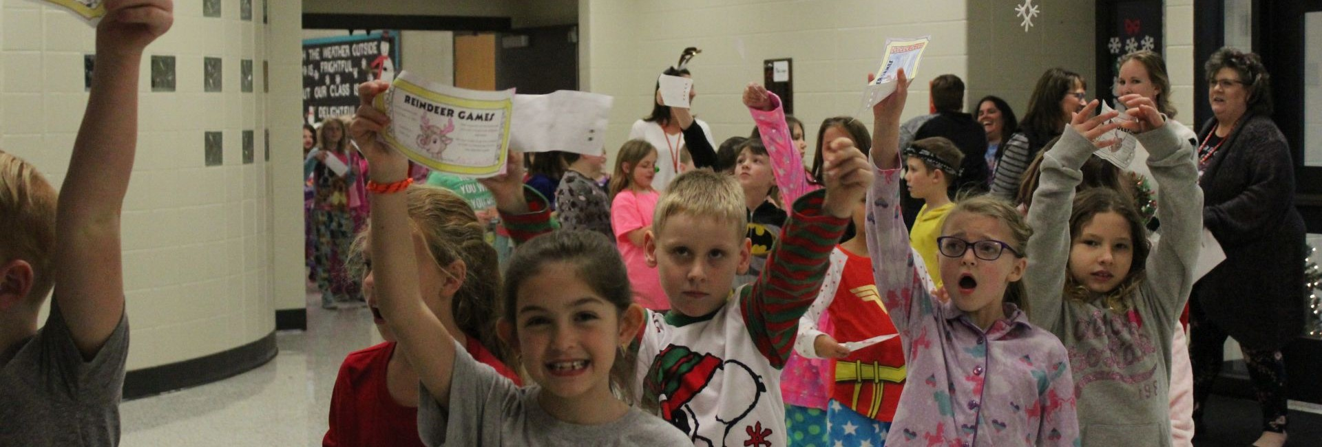WES students showing their Reindeer Game Tickets