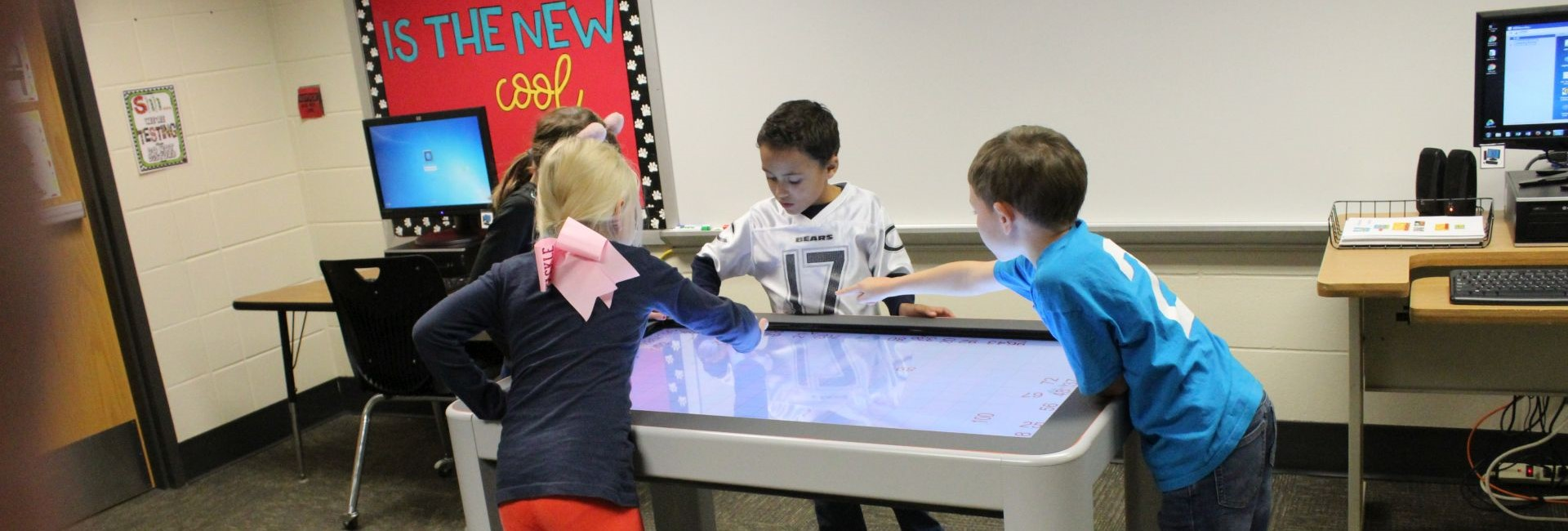 Mrs. Rockley's Students Working on the Promethean Table
