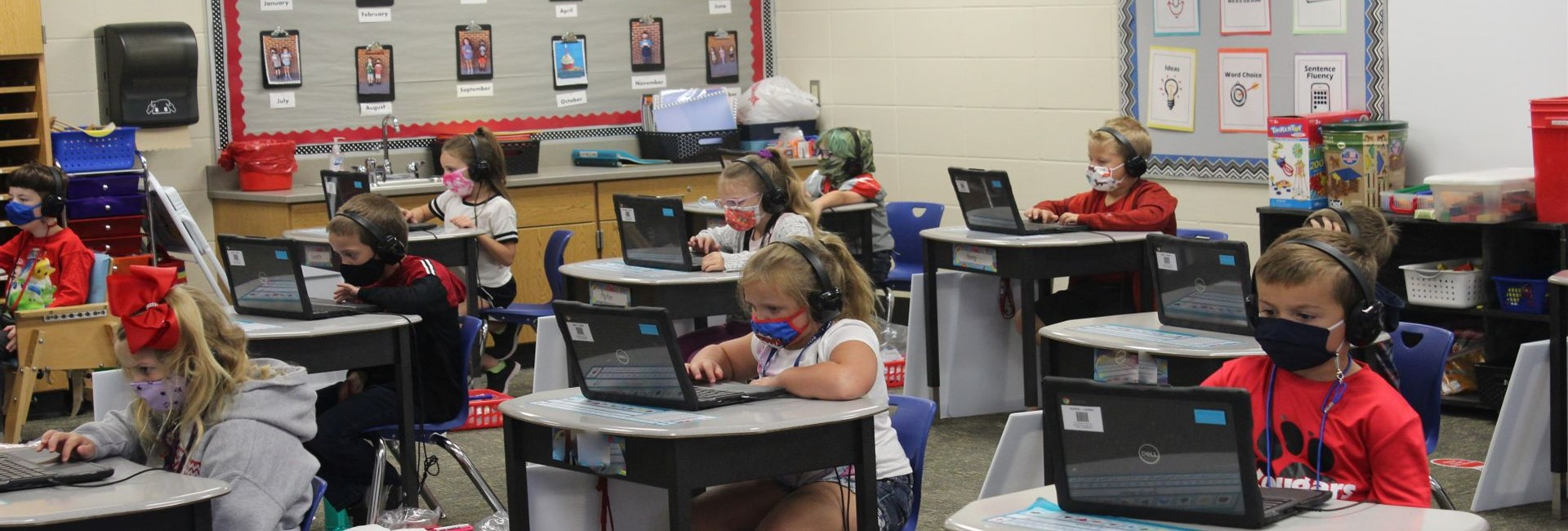 Look at these First Graders - they are aWESome on their Chromebooks! Mrs. Hazlett - your class rocks!